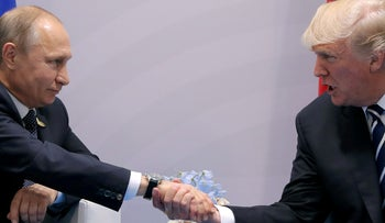File photo: U.S. President Donald Trump and Russian counterpart Vladimir Putin hold a bilateral meeting in Hamburg, Germany, July 2017.