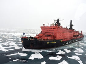 A Russian nuclear-powered icebreaker pushing through Arctic ice.