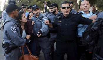 Israeli police detain a woman during a protest outside a hospital in Jerusalem where Samir Arbid is being treated, October 1, 2019.