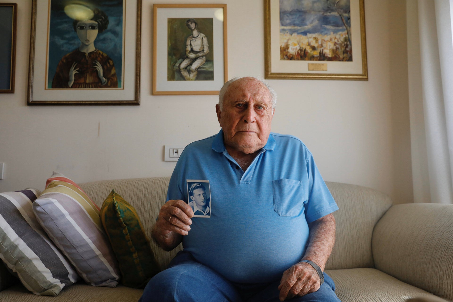 Yehuda (Poldak) Meimon with his picture from the 'Avengers', at his home in Ramat Gan, Israel.