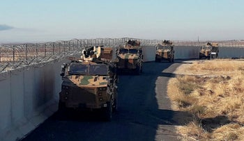 Turkish army armoured vehicles arrive near the Turkish town of Idil at the Turkey-Syria border before Turkish and Russian troops conduct their third joint patrols in northeast Syria, November 8, 2019.