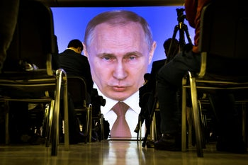 File photo: Journalists watch as Russian President Vladimir Putin gives his annual state of the nation address in Manezh in Moscow, March 2018.