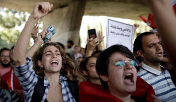 Demonstrators chant slogans and gesture during ongoing anti-government protests in Beirut, Lebanon November 6, 2019.