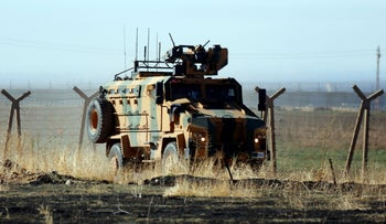 A Turkish army vehicles is driven in the outskirts of Alakamis, in Idil province, southeastern Turkey, after conducting a joint patrol with Russian forces in Syria, Friday, November 8, 2019.