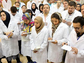 In this photo released by the Atomic Energy Organization of Iran, journalists take notes while visiting Fordo nuclear site near Qom, south of Tehran, Iran Saturday, November 9, 2019.