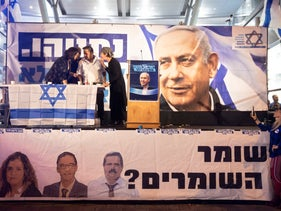 Activists protest Netanyahu's indictment in front of the Attorney General's office, October 29, 2019
