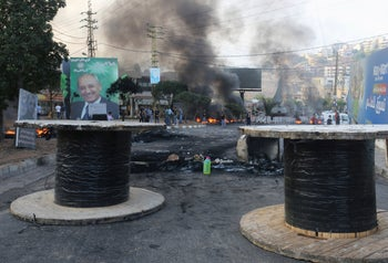 Barricades block a street during an anti-government protest with a billboard of parliament speaker Nabih Berri in the background. Nabatiyeh, southern Lebanon October 18, 2019