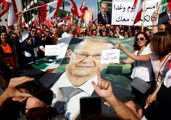 Supporters of Lebanon's President Michel Aoun hold his poster during a rally to support him. Baabda near Beirut, Lebanon, November 3, 2019