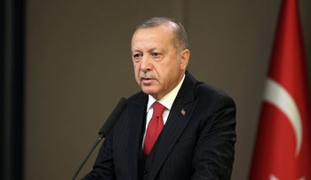 Recep Tayyip Erdogan speaks to reporters, in Ankara, Turkey, November 7, 2019