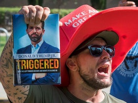 A supporter of President Trump yells at counter protesters outside a book promotion by Donald Trump Jr. at the UCLA campus in Westwood, California on November 10, 2019