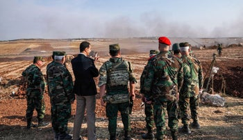 President Bashar al-Assad (3rd-L) speaking with Syrian army officers in Idlib province, October 22, 2019
