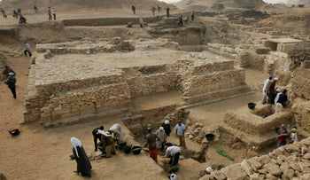 Archaeologists work at a site in Saqqara near Cairo.