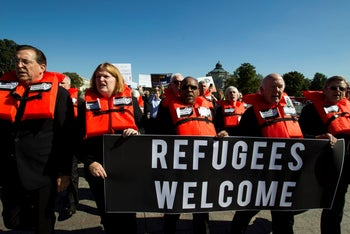 Faith leaders and members of human rights groups wearing a life vests march outside of the U.S. Capitol to protest Trump administration plans to end the U.S. refugee resettlement program. Oct. 15, 2019
