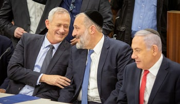 Shas leader Arye Dery in-between Benny Gantz, Netanyahu at the Knesset in Jerusalem, April 11, 2019.