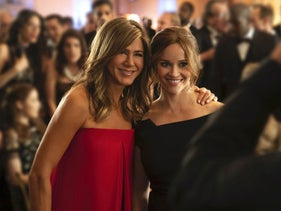 """Jennifer Aniston, left, and Reese Witherspoon in a scene from Apple TV's """"The Morning Show."""""""
