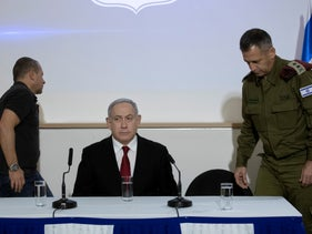 Netanyahu is joined by Argaman (left) and Cochavi (right) at a press conference on the security situation, November 12, 2019.