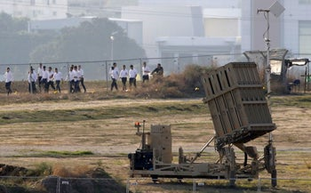 Religious students walk past an Iron Dome battery after Islamic Jihad fired rockets into Israel's south, November 12, 2019.