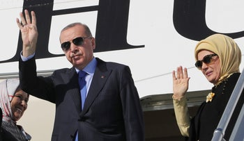 Turkish President Recep Tayyip Erdogan and his wife Emine Erdogan wave as they board a plane before a visit to the United States, in Ankara, Nov. 12, 2019.