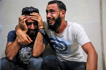 Relatives of Palestinian Zaki Ghanama, 25, mourn in the morgue of a hospital in Beit Lahia in the northern Gaza Strip on November 12, 2019.