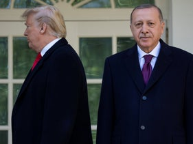 President Donald Trump walks off toward the Oval Office after posing for photographers with Turkish President Recep Tayyip Erdogan before meeting, Wednesday, November 13, 2019