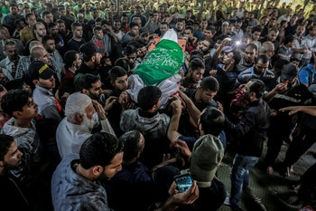 Gazans carry the body of a man killed in the fighting between Israel and Islamic Jihad, November 13, 2019.