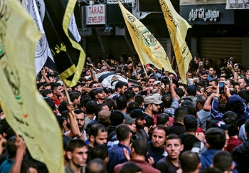 Mourners chant slogans as they carry the body of Palestinian Islamic Jihad senior leader Baha Abu Al-Ata during his funeral in Gaza City on November 12, 2019