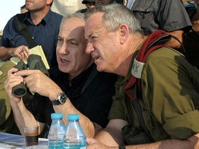 Prime Minister Benjamin Netanyahu speaks to Benny Gantz while visiting an IDF Golani Brigade exercise in the Golan Heights, in 2012.