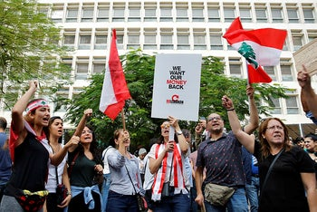Anti-government protesters chant slogans during a demonstration, in front of the Central Bank, in Beirut, Lebanon, October 28, 2019.