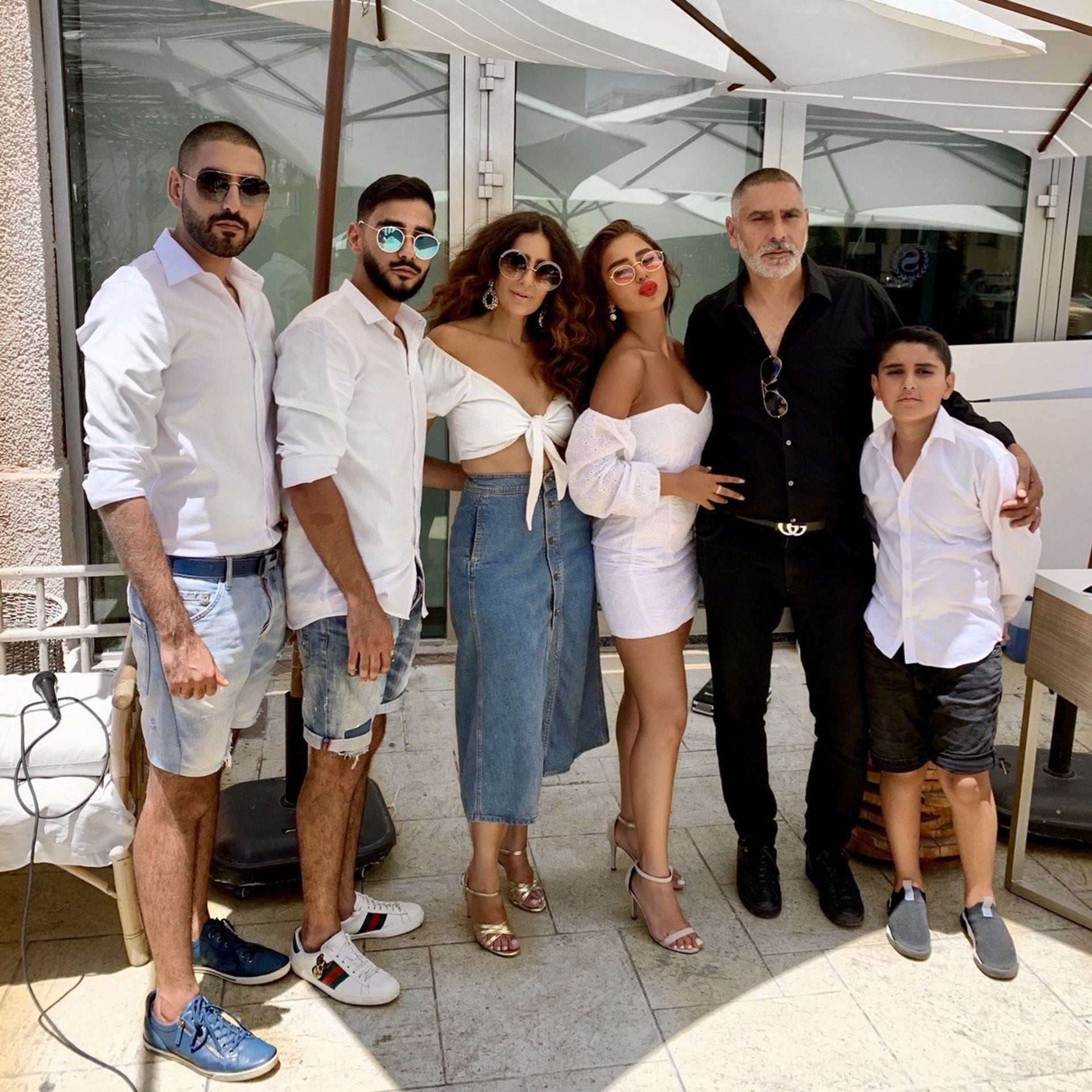 Aline Cohen, third from right, with her family. Her mother manages her daughter's career, while her father, a lawyer by profession, is her legal counsel and draws up her contracts.