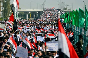 Iraqi students take part in anti-government demonstrations in the central holy city of Najaf on November 13, 2019.
