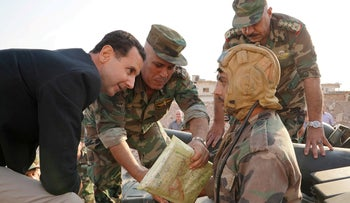 Syrian President Bashar al Assad visits Syrian army troops in war-torn northwestern Idlib province, Syria, in this handout released by SANA on October 22, 2019.
