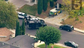 This photo from video provided by KTLA-TV shows law enforcement personnel outside a home in connection with shooting at Saugus High School on Thursday, Nov. 14, 2019 in Santa Clarita, Calif.