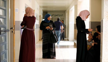 Bedouin women wait to cast their vote just outside a polling station during Israel's parliamentary election in the Bedouin town of Rahat in southern Israel September 17, 2019.