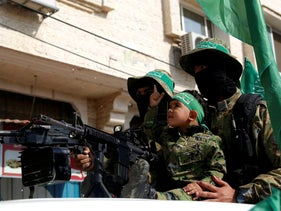 Hamas gunmen march with their weapons in Khan Younis, southern Gaza Strip, November 11, 2019.