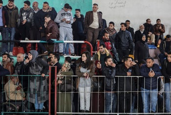 Palestinians wait at a makeshift station for travel permits to cross into Egypt through the Rafah crossing after it was reopened by Egyptian authorities, in Khan Younis, Southern Gaza Strip, February 21, 2018.