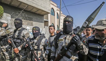Palestinian Islamic Jihad militants attend the funeral of a comrade in Khan Yunis in the southern Gaza Strip, November 14, 2019.