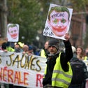 A protester holds a placard during a demonstration marking the first anniversary of the 'yellow vest' movement in Toulouse, November 16, 2019.