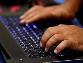 File photo: A man types into a keyboard during the Def Con hacker convention in Las Vegas, Nevada, July 29, 2017.