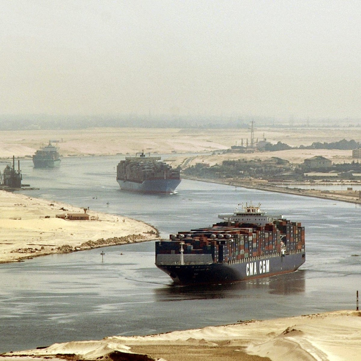 In this Sept. 21, 2009 file photo, cargo ships sail through the Suez Canal, seen from a helicopter, near Ismailia, Egypt.
