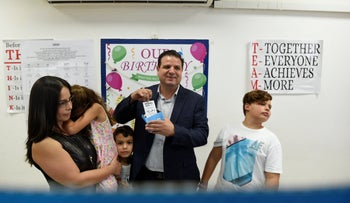 Joint List chairman Ayman Odeh voting in Haifa.