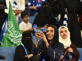 Saudi women attend a football match in Riyadh, November 9, 2019.