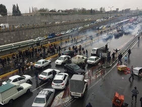 People stop their cars on the highway in Tehran, Iran, to protest against increased gas prices, November 16, 2019.