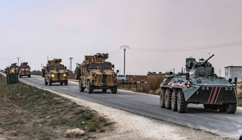 Turkish military vehicles patrol in the countryside of Darbasiyah town in Syria's northeastern Hasakeh province, November 1, 2019.