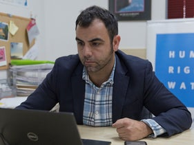 Omar Shakir, the local director of Human Rights Watch, works at his office in the West Bank city of Ramallah, November 5, 2019.