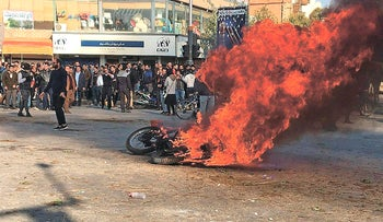 A motorcycle on fire during a protest in the Iranian city of Isfahan, November 2019.