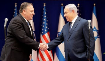 U.S. Secretary of State Mike Pompeo, left, shakes hands with Israeli Prime Minister Benjamin Netanyahu, during a meeting at the Prime Minister's residence in Jerusalem, October 18, 2019