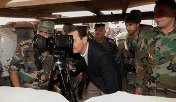 Syrian President Bashar Assad visits Syrian army troops in the northwestern Idlib province, Syria, October 22, 2019.