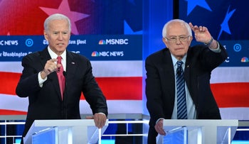 Democratic presidential hopefuls Former Vice President Joe Biden (L) and Vermont Senator Bernie Sanders (R) speak during the fifth Democratic primary debate of the 2020 presidential campaign season co-hosted by MSNBC and The Washington Post at Tyler Perry Studios in Atlanta, Georgia on November 20, 2019.