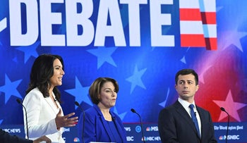 Democratic presidential hopefuls (L-R) New Jersey Senator Cory Booker, Representative for Hawaii Tulsi Gabbard, Minnesota Senator Amy Klobuchar and Mayor of South Bend, Indiana, Pete Buttigieg participate in the fifth Democratic primary debate of the 2020 presidential campaign season co-hosted by MSNBC and The Washington Post at Tyler Perry Studios in Atlanta, Georgia on November 20, 2019