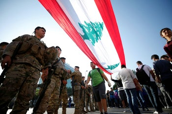 Lebanese army soldiers standing guard as students take part in a protest in the southern city of Sidon, Lebanon, November 5, 2019.